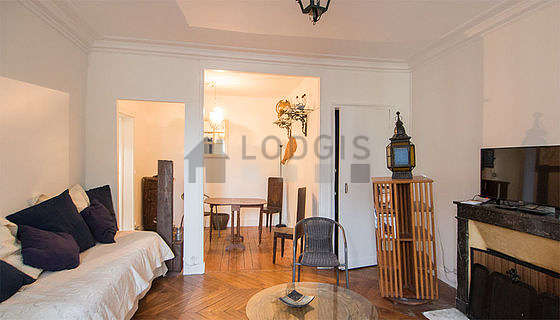Quiet living room furnished with 1 bed(s) of 90cm, tv, wardrobe, 4 chair(s)