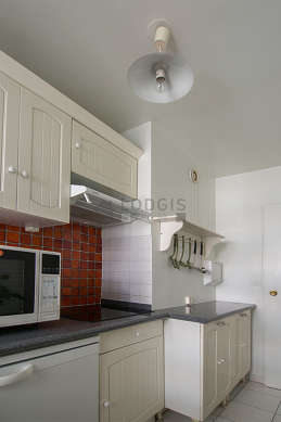 Kitchen where you can have dinner for 2 person(s) equipped with washing machine, refrigerator, freezer, hood