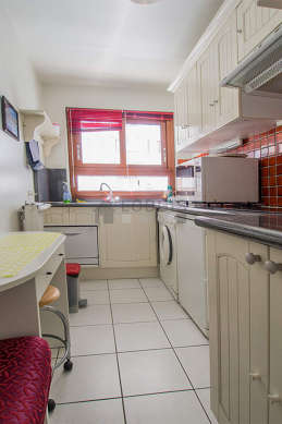 Kitchen equipped with cookware, stool