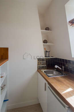 Kitchen where you can have dinner for 2 person(s) equipped with washing machine, stool