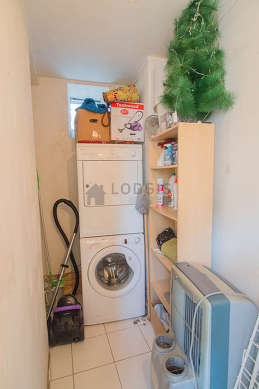 Laundry room with tile floor and equipped with washing machine, dryer