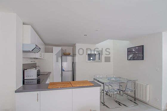 Magnifique cuisine de 7m²ouverte sur le séjour avec du dallage au sol