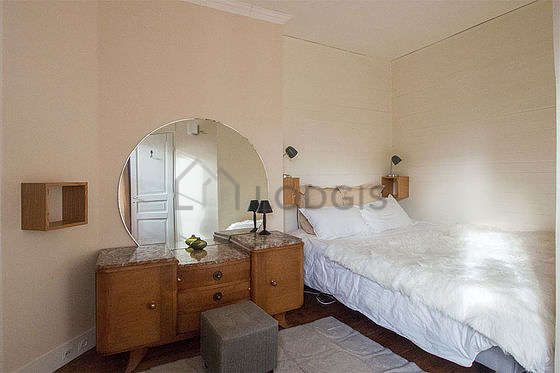 Bedroom with windows facing the road