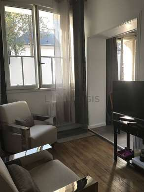 Very quiet living room furnished with tv, 1 armchair(s), 4 chair(s)