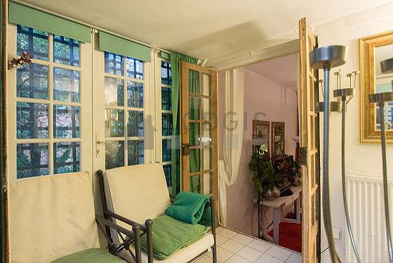 Quiet veranda equipped with 2 armchair(s)