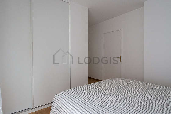 Bedroom equipped with closet, cupboard, bedside table