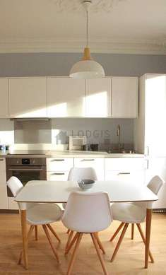Beautiful kitchenopens on the living room with wooden floor