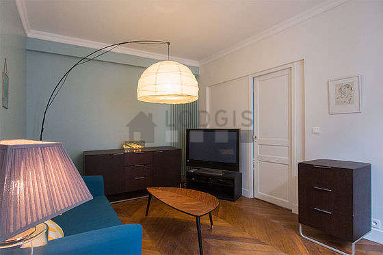 Very quiet living room furnished with tv, dvd player, storage space
