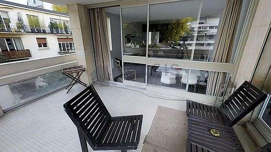 Very quiet and very bright balcony with concrete floor