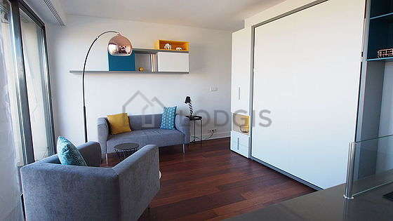 Very quiet living room furnished with 1 murphy bed(s) of 140cm, tv, 1 armchair(s), 4 chair(s)