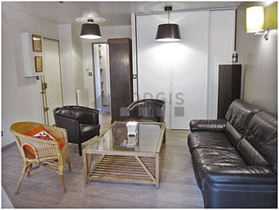 Quiet living room furnished with tv, 3 armchair(s)
