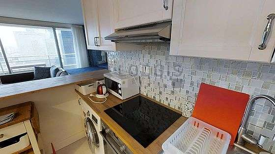 Kitchen where you can have dinner for 4 person(s) equipped with washing machine, refrigerator, hood, cookware