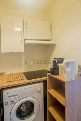 Kitchen equipped with washing machine, refrigerator, freezer, hood