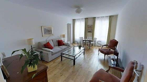 Very quiet living room furnished with tv, wardrobe, cupboard, 5 chair(s)