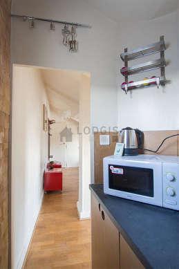 Magnifique cuisine de 2m² avec du linoleum au sol