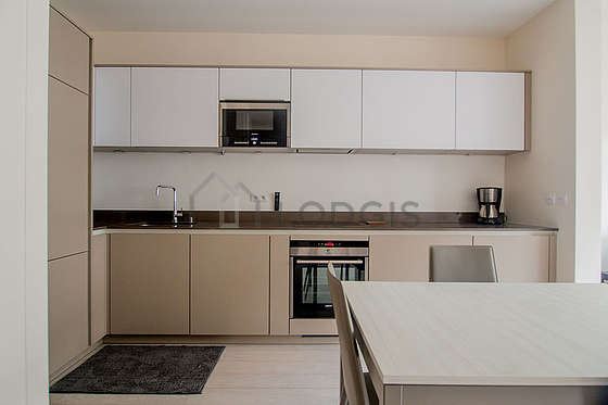 Kitchen equipped with washing machine, refrigerator, hood, cookware