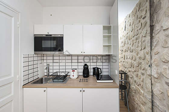 Great kitchenopens on the living room with wooden floor