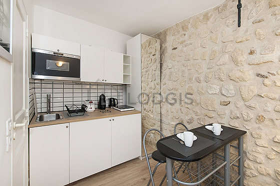 Kitchen where you can have dinner for 2 person(s) equipped with washing machine, refrigerator, freezer, crockery