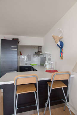 Kitchen where you can have dinner for 3 person(s) equipped with dishwasher, hob, refrigerator, extractor hood
