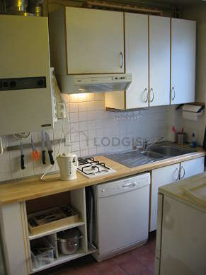 Kitchen equipped with dryer, refrigerator, hood, cookware