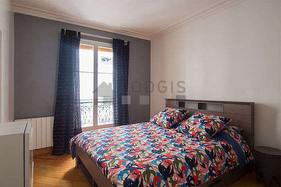 Bright bedroom equipped with closet, cupboard, bedside table