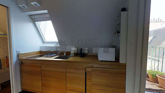Beautiful kitchen of 2m² with its wooden floor