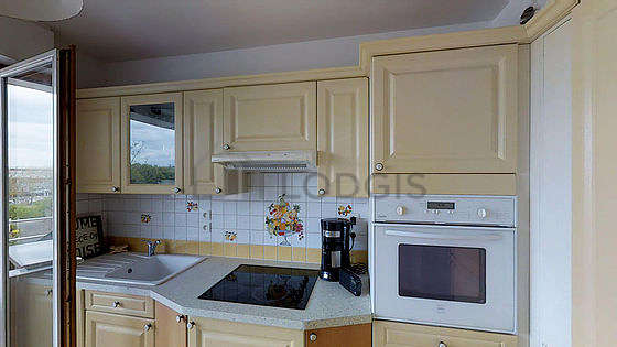 Kitchen where you can have dinner for 4 person(s) equipped with washing machine, refrigerator, cookware