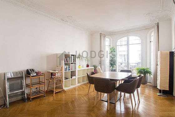 Dining room equipped with dining table, bookcase, fireplace