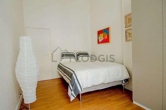 Bedroom with its wooden floor