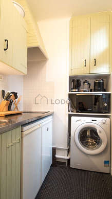 Kitchen equipped with washing machine, refrigerator, freezer, extractor hood