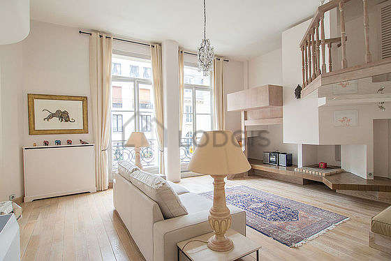 Very quiet living room furnished with tv, hi-fi stereo, 6 chair(s)