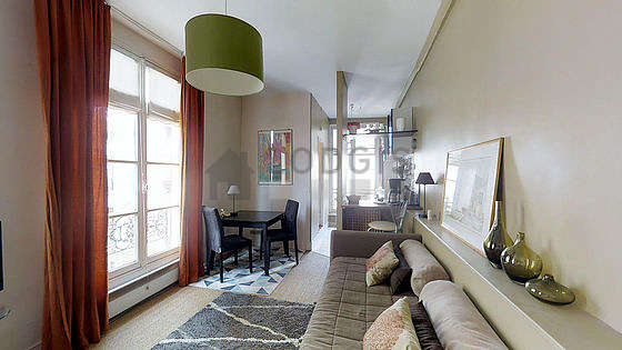 Quiet living room furnished with 1 sofabed(s) of 160cm, air conditioning, tv, dvd player