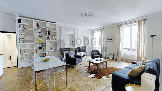 Very quiet living room furnished with tv, 2 armchair(s)