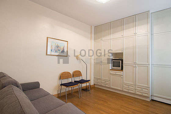 Quiet living room furnished with tv, cupboard, 4 chair(s)