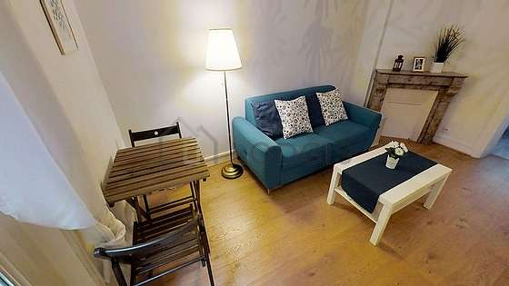 Very quiet living room furnished with tv, storage space, 2 chair(s)