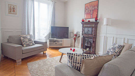 Very quiet living room furnished with tv, 1 armchair(s)