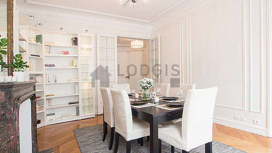 Dining room equipped with dining table, fireplace