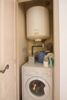 Laundry room with tile floor and equipped with washing machine