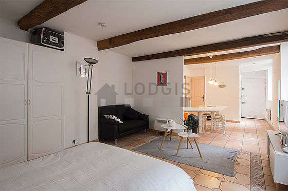 Very quiet living room furnished with 1 bed(s) of 140cm, tv, closet