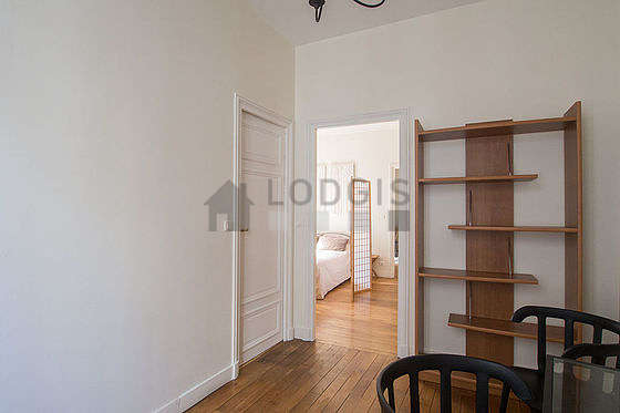 Beautiful entrance with wooden floor and equipped with 2 chair(s)