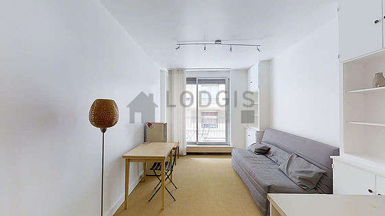 Quiet living room furnished with 1 sofabed(s) of 140cm, sofa, storage space, cupboard