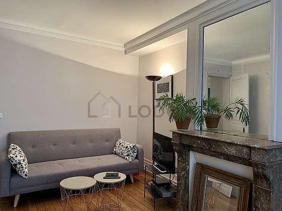 Quiet living room furnished with tv, hi-fi stereo, 2 chair(s)
