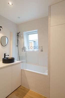 Pleasant and bright bathroom with wooden floor