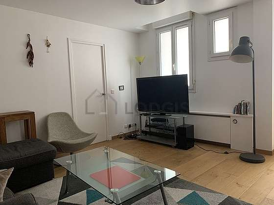 Bright living room furnished with 1 armchair(s), 6 chair(s)