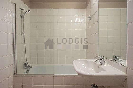 Bathroom equipped with bath tub, shower in bath tub