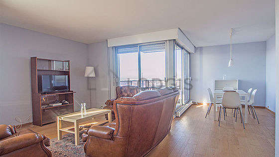 Very quiet living room furnished with tv, 1 armchair(s), 6 chair(s)