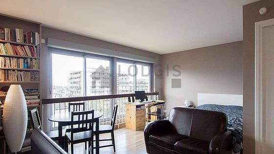 Very quiet living room furnished with 1 bed(s) of 140cm, tv, 5 chair(s)
