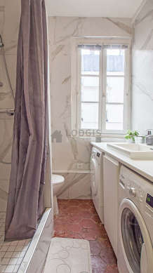 Pleasant and bright bathroom with paving floor