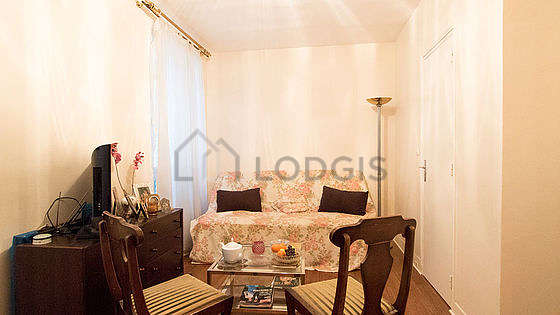 Very quiet living room furnished with 1 sofabed(s) of 120cm, tv, storage space, 3 chair(s)