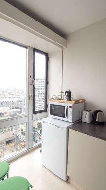 Kitchen equipped with washing machine, refrigerator, freezer, cookware